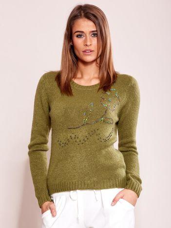 Zielony sweter damski z cekinami