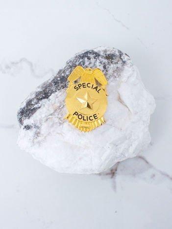 Złota metalowa odznaka policyjna