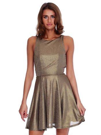 Złota połyskująca sukienka z wycięciami
