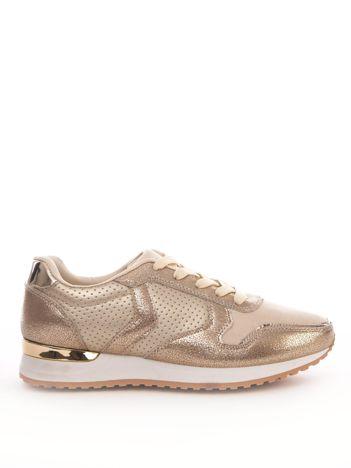Złote buty sportowe z ażurową cholewką i przeszyciami