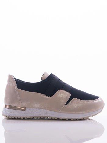 Złote buty sportowe z przecieranymi wstawkami i lustrzaną wstawką na pięcie