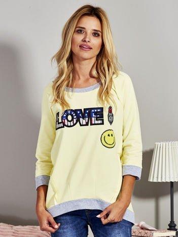 Żółta bluza z cekinowym napisem LOVE i kokardami z tyłu