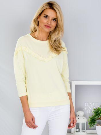 Żółta bluzka z falbankami i perełkami
