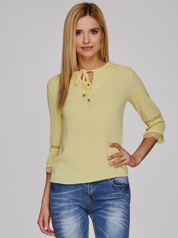 Żółta bluzka z wiązaniem
