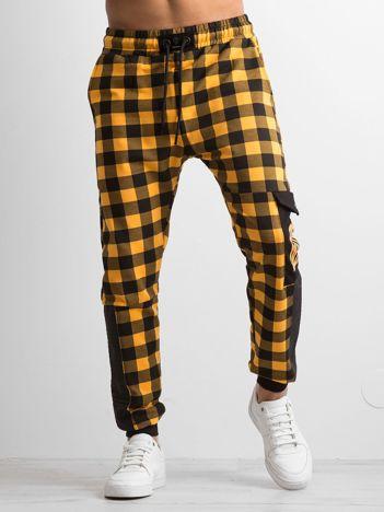 Żółte męskie spodnie dresowe w kratę
