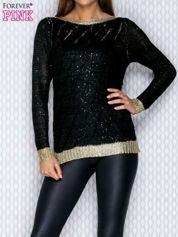 Ażurowy sweter czarny ze złotym wykończeniem