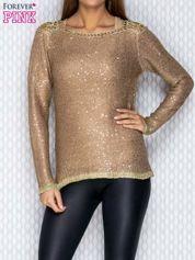 Beżowy sweter ze złotymi wstawkami