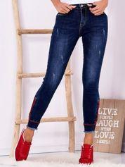 Ciemnoniebieskie jeansowe spodnie z suwakami