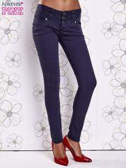 Ciemnoniebieskie strechowe spodnie skinny z kieszeniami
