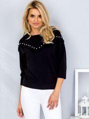 Czarna bluzka z falbankami i perełkami
