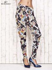 Czarne lejące spodnie z kwiatowym nadrukiem