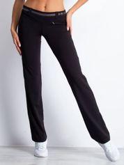 Czarne spodnie dresowe z aplikacją z dżetów