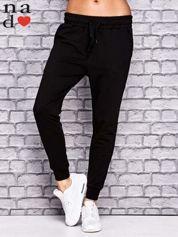 Czarne spodnie dresowe z troczkami