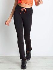 Czarne termoaktywne spodnie do biegania o prostej nogawce z fluoróżową wstawką ♦ Performance RUN