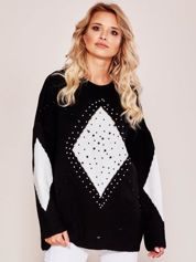 Czarny sweter oversize z aplikacją