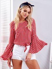 Czerwona bluzka w kratkę z wiązaniem na dole