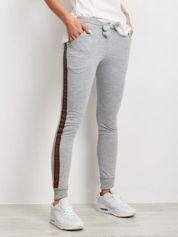 Damskie spodnie dresowe z lampasami szare