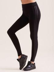Dopasowane legginsy z lamówką z ekoskóry czarne