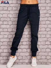 FILA Granatowe spodnie dresowe z kieszonką na nogawce