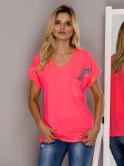 Fluo różowa bluzka z błyszczącą aplikacją