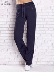 Grafitowe spodnie dresowe z kieszeniami i przeszyciami PLUS SIZE