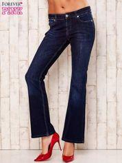 Granatowe rozszerzane spodnie jeansowe