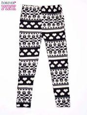 Kremowe legginsy dziewczęce w serduszka i śnieżynki