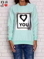 Miętowa bluza z błyszczącym nadrukiem