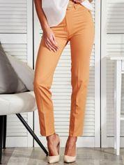 Musztardowe spodnie z paskiem