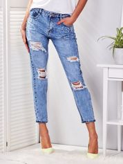 Niebieskie jeansy z przedarciami i perełkami PLUS SIZE