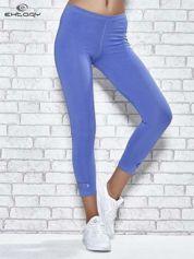 Niebieskie legginsy sportowe z patką z dżetów na dole