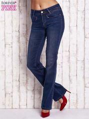 Niebieskie spodnie jeansowe boot cut