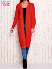 Pomarańczowy długi sweter z dzianiny