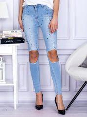 Spodnie jeansowe z dziurami i perełkami niebieskie