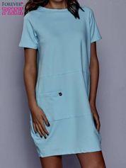 Turkusowa sukienka dresowa z kieszenią z boku