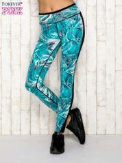 Turkusowe legginsy z siateczkowymi wstawkami