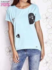 Turkusowy t-shirt z motywem serca i kokardki