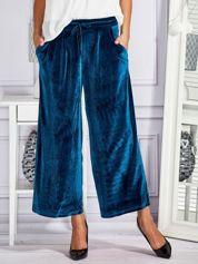 Welurowe spodnie flare z troczkami turkusowe