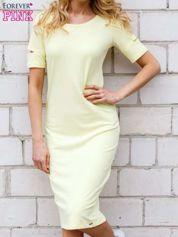Żółta sukienka z rozcięciami na rękawach