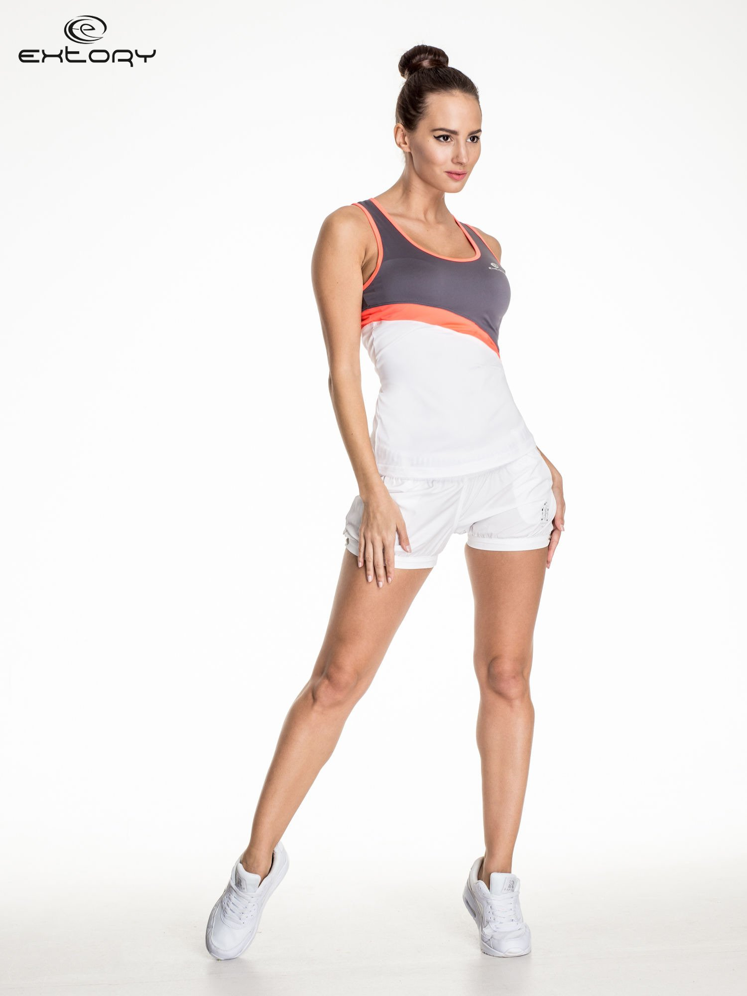 Biały damski top sportowy z szaro-koralowym modułem                                  zdj.                                  2