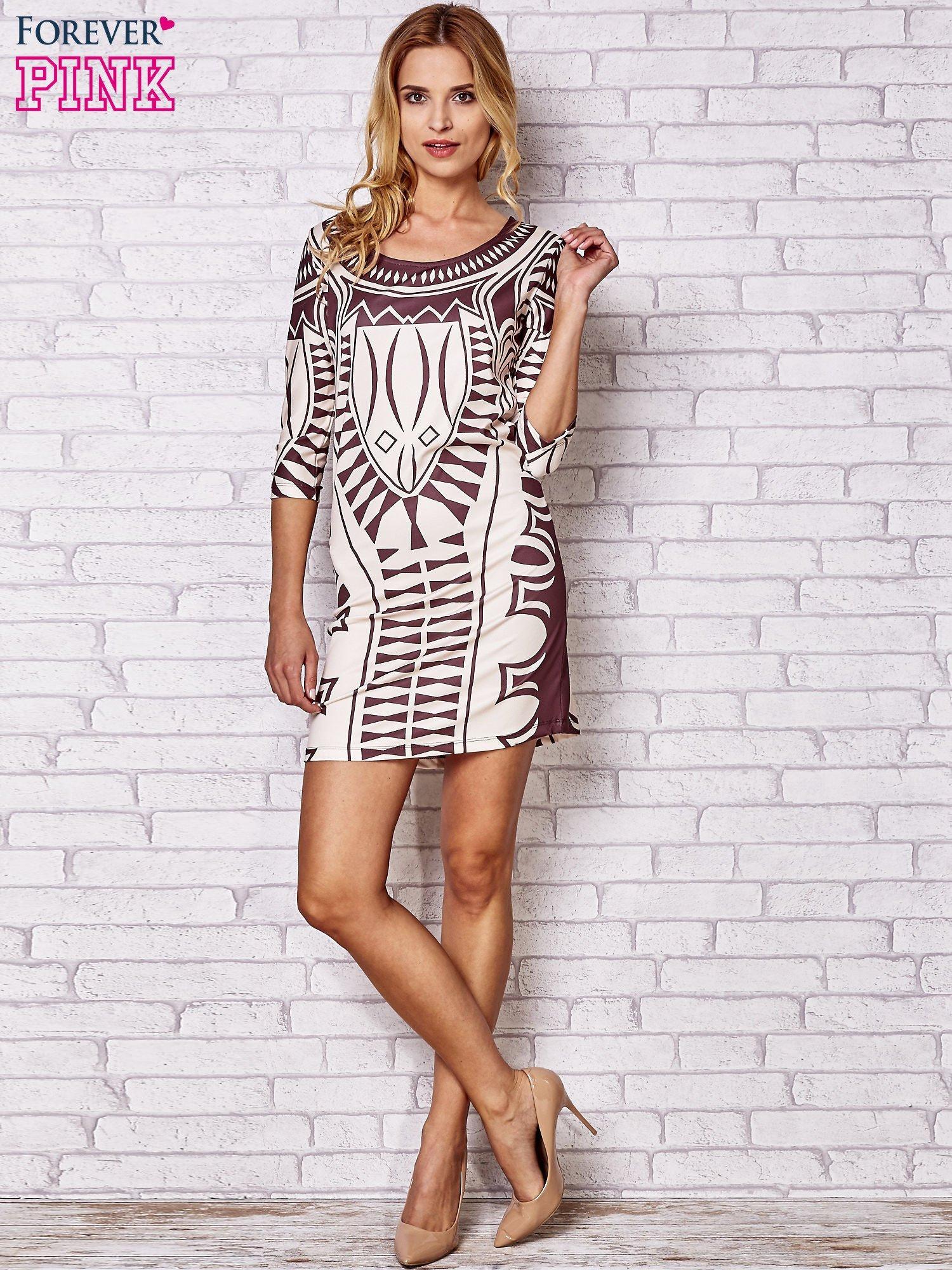 3168d52b Brązowa sukienka w geometryczne wzory