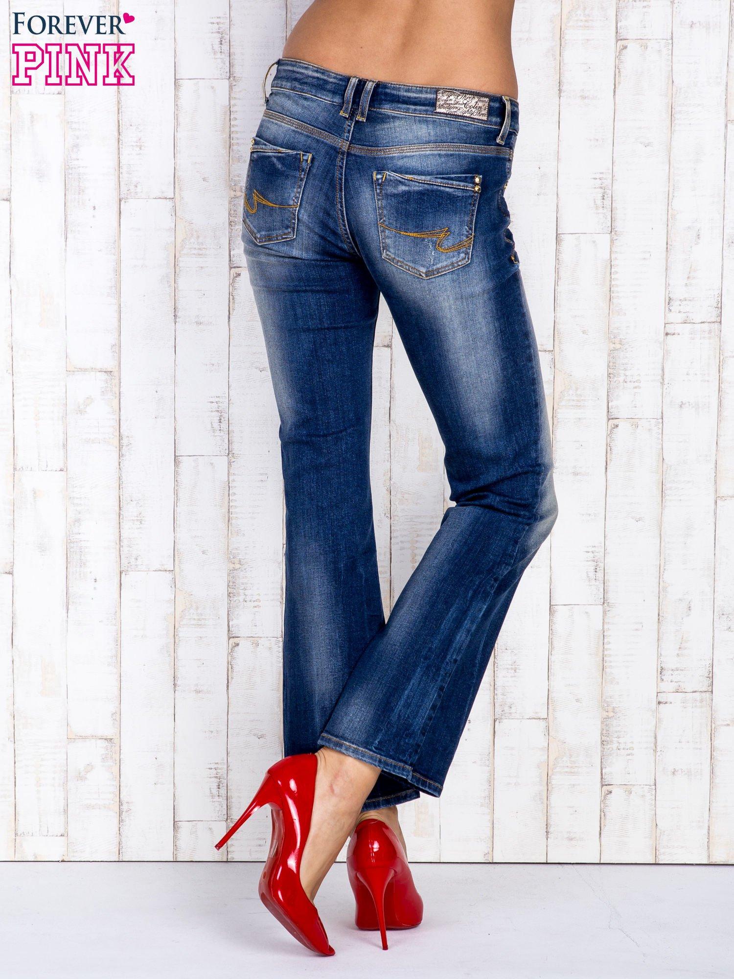 Ciemnoniebieskie spodnie dzwony jeansowe z przetarciami                                  zdj.                                  2