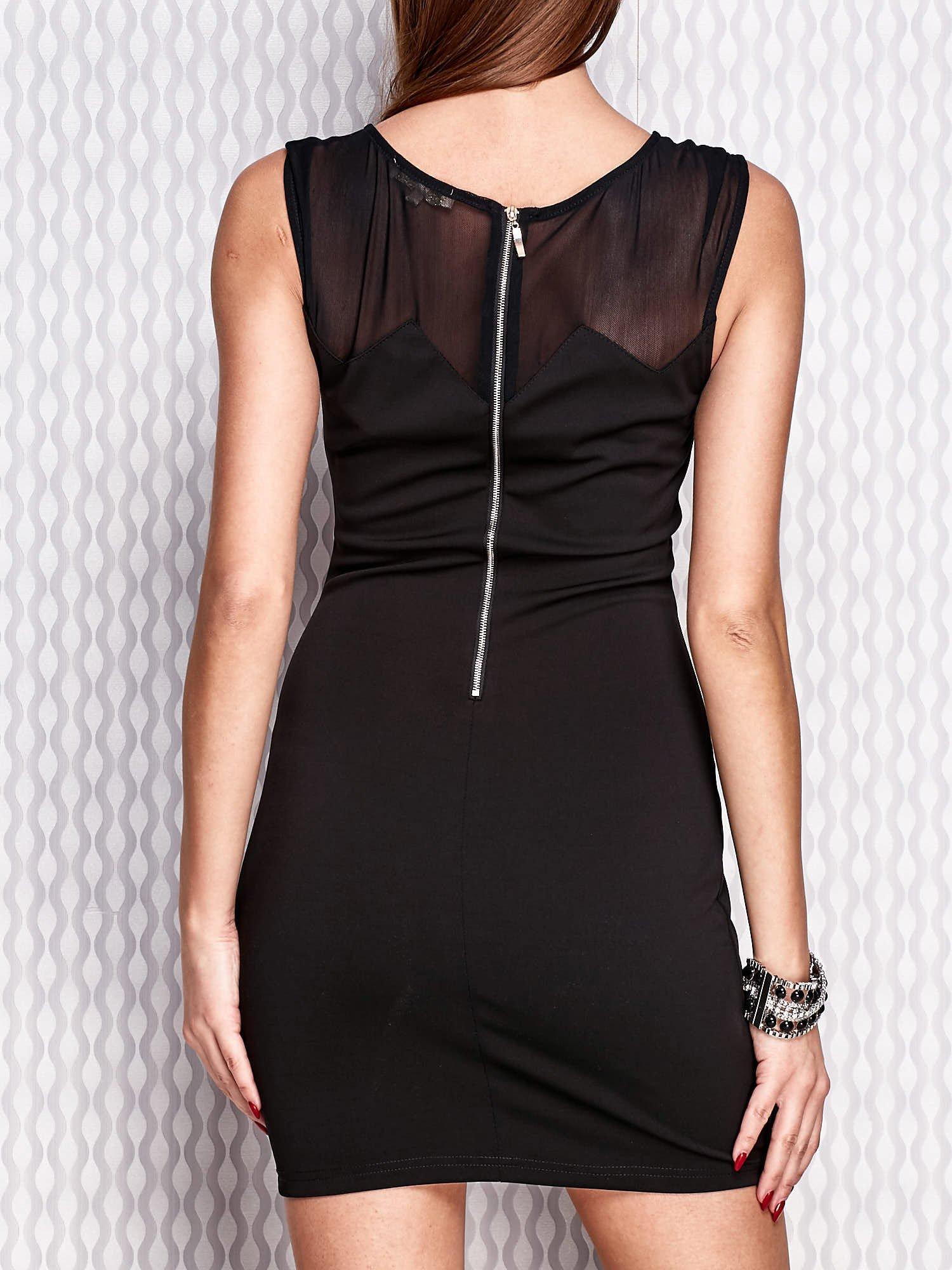 a22693db8e Czarna dopasowana sukienka z błyszczącą aplikacją - Sukienka ...