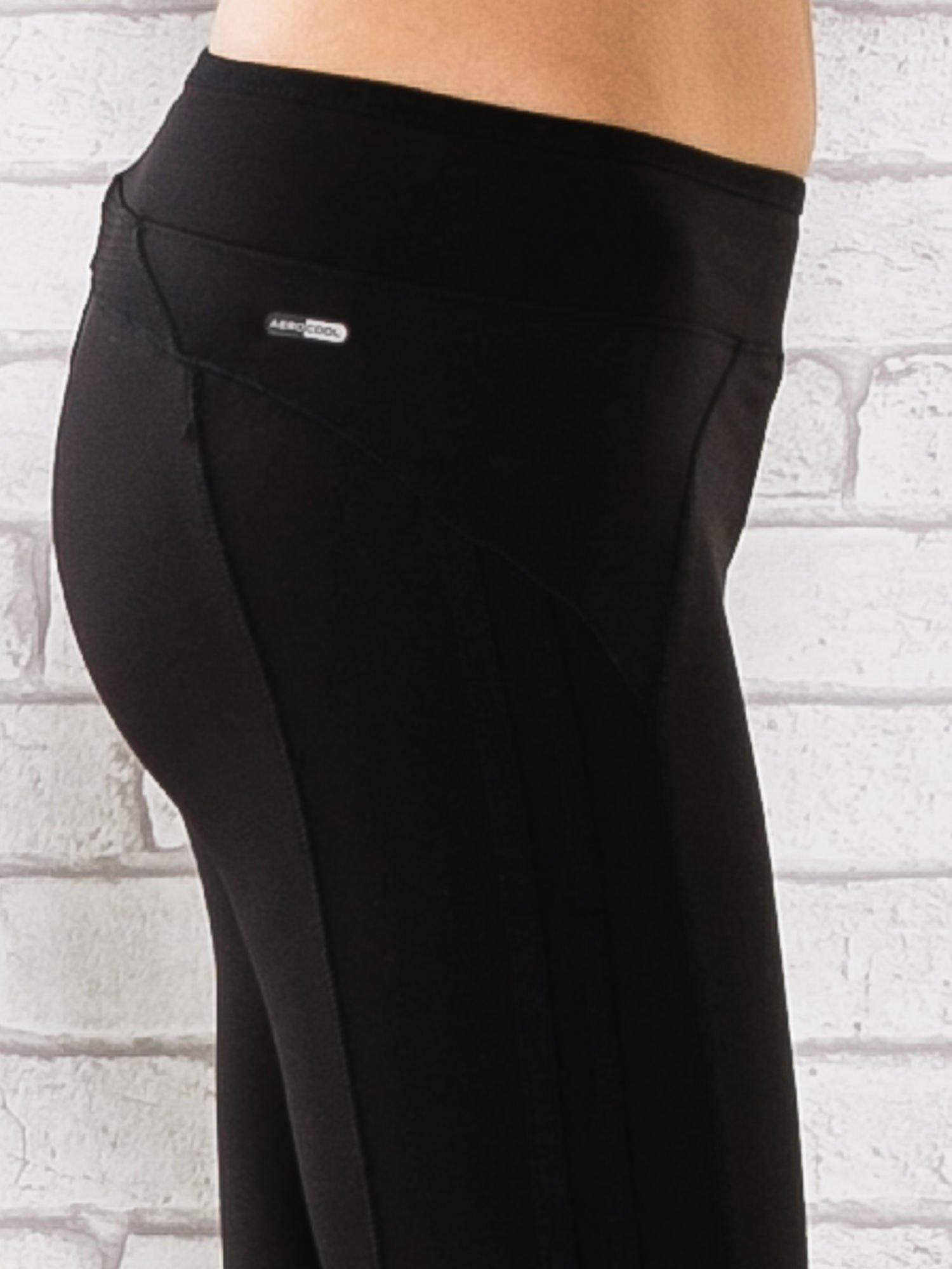 Czarne legginsy 3/4 sportowe termalne z lampasami                                  zdj.                                  5