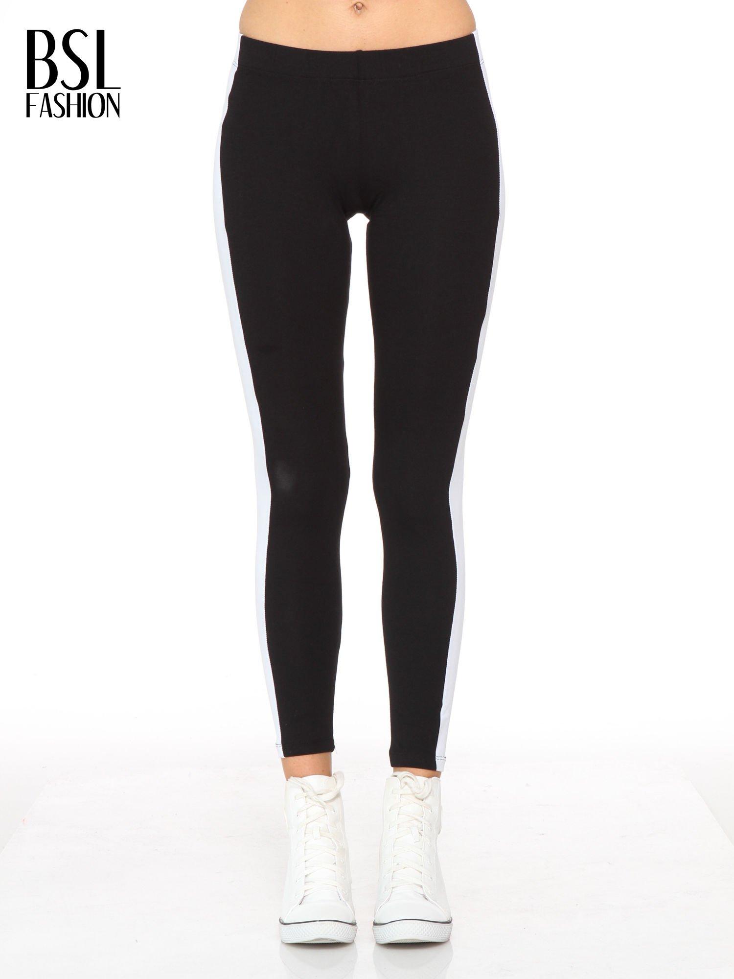 db3863ce2ca845 Czarne legginsy z białymi modułami wzdłuż nogawek - Spodnie legginsy - sklep  eButik.pl