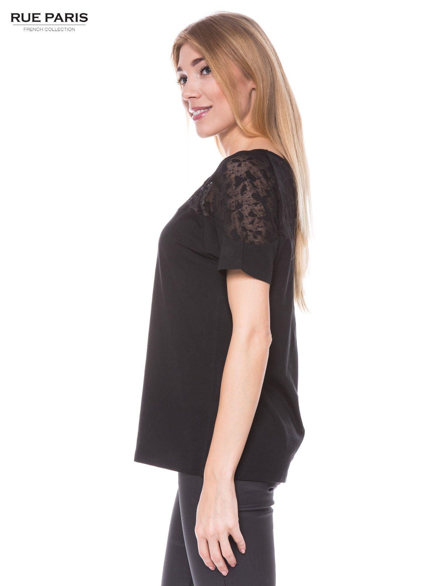 Czarny t-shirt z transparentną górą w kokardki                                  zdj.                                  2