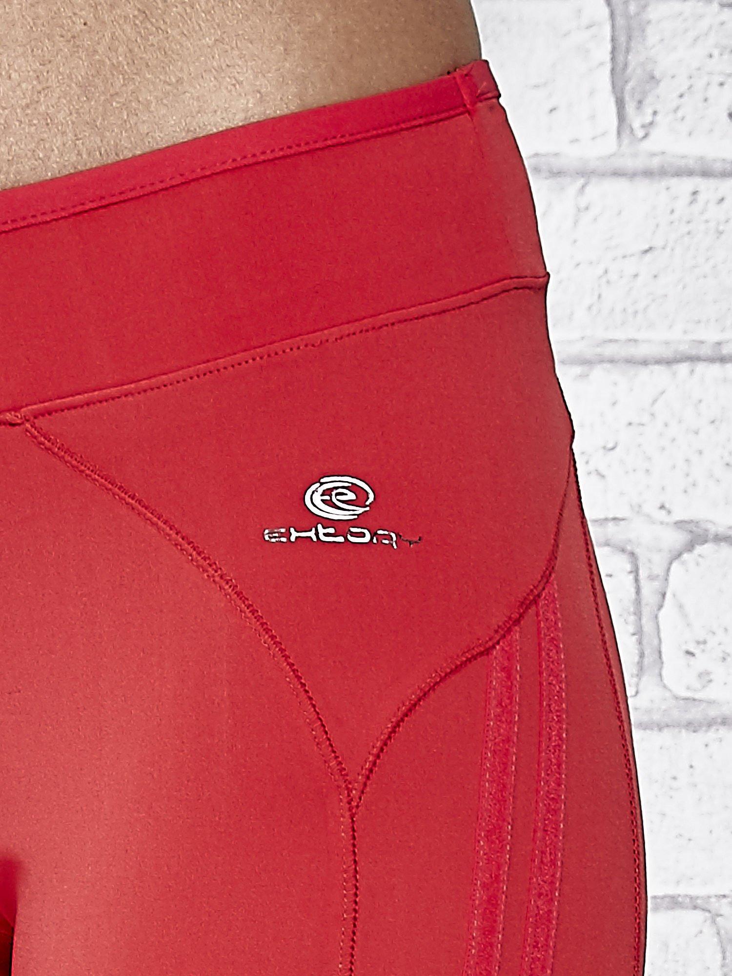 Czerwone legginsy 3/4 sportowe termalne z lampasami                                  zdj.                                  7