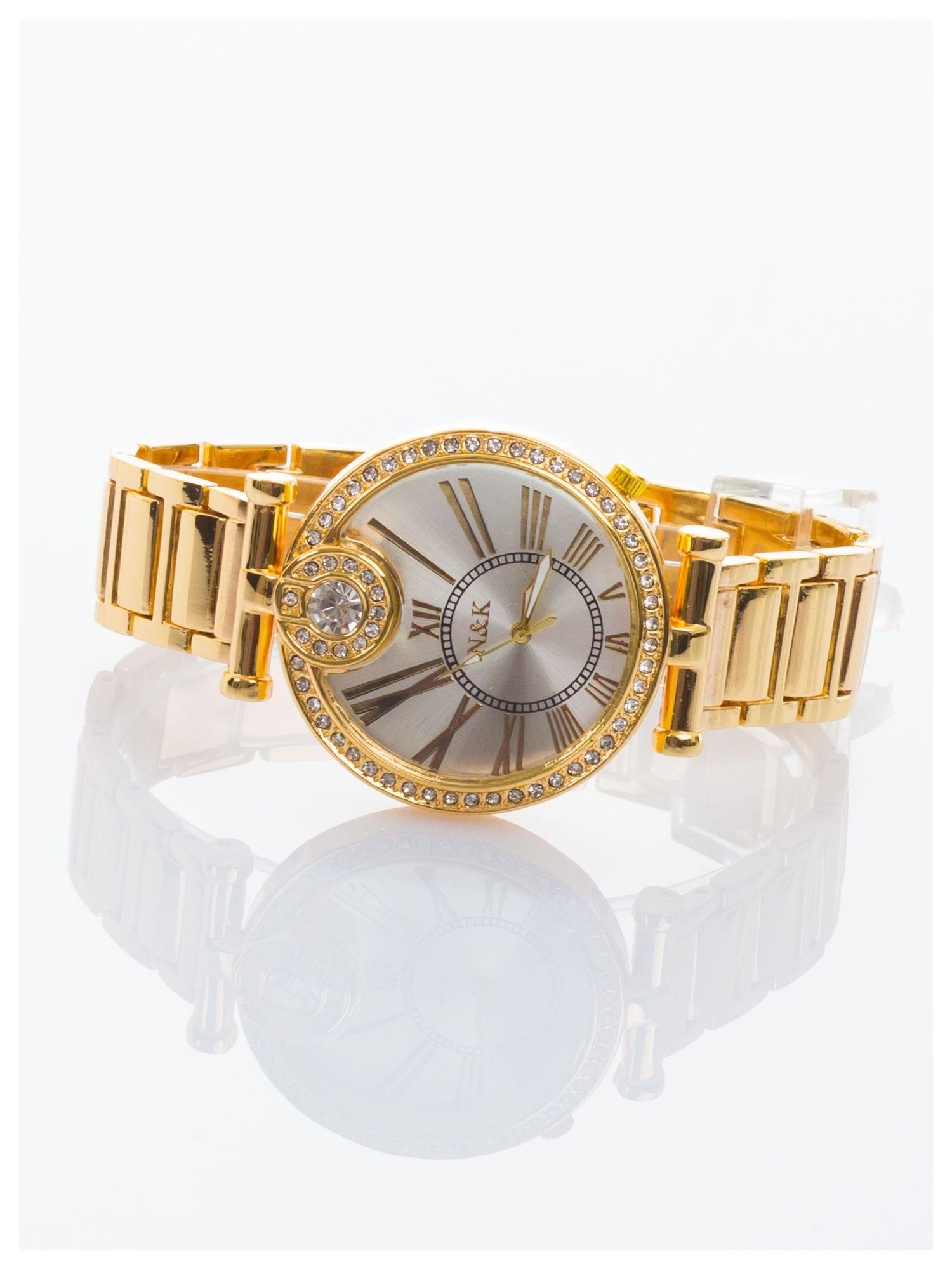 Damski złoty zegarek na bransolecie. Duża, ozdobna tarcza. Cyrkonie.                                  zdj.                                  2