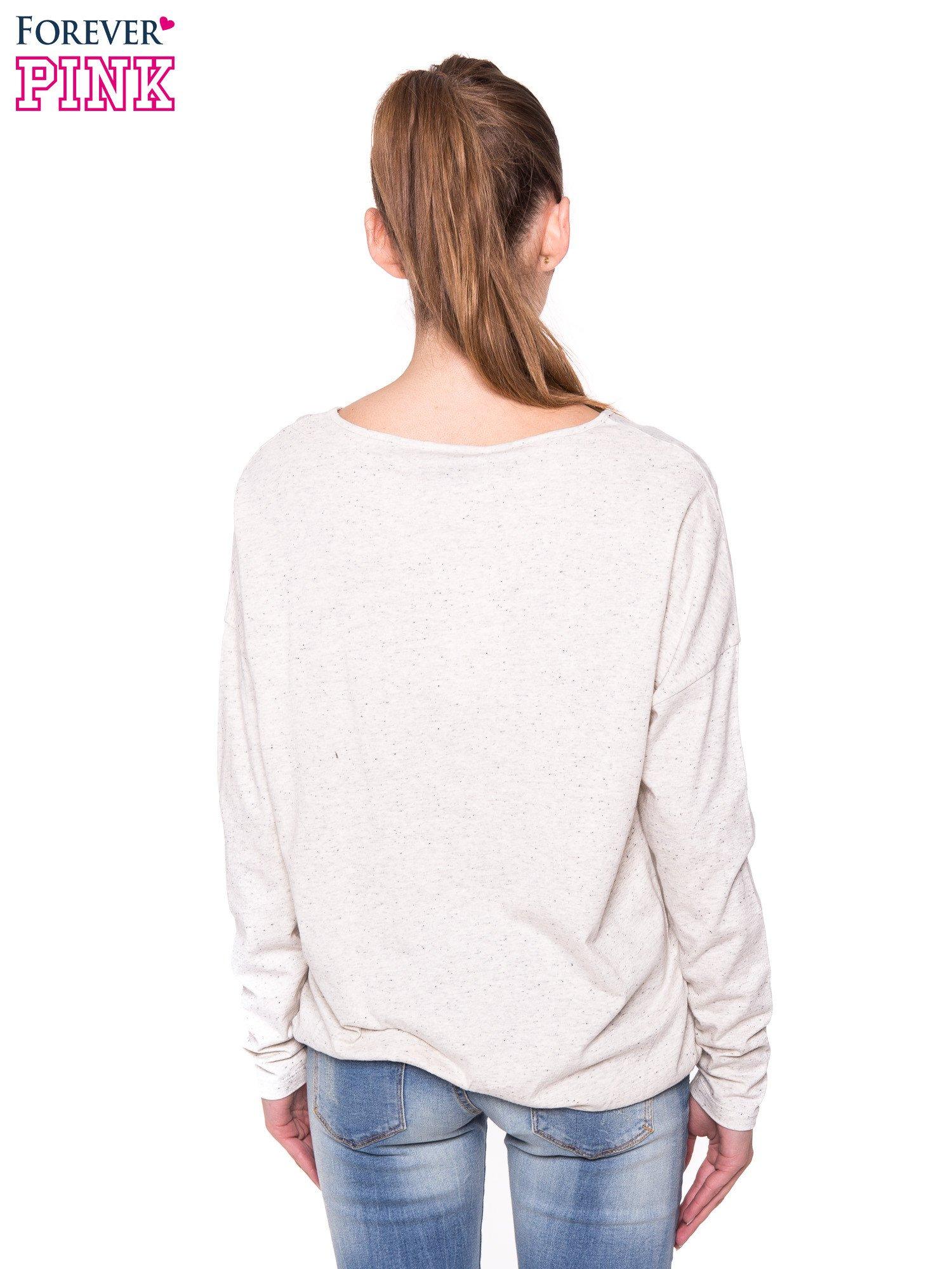 Ecru melanżowa bluzka z gumką u dołu                                  zdj.                                  3