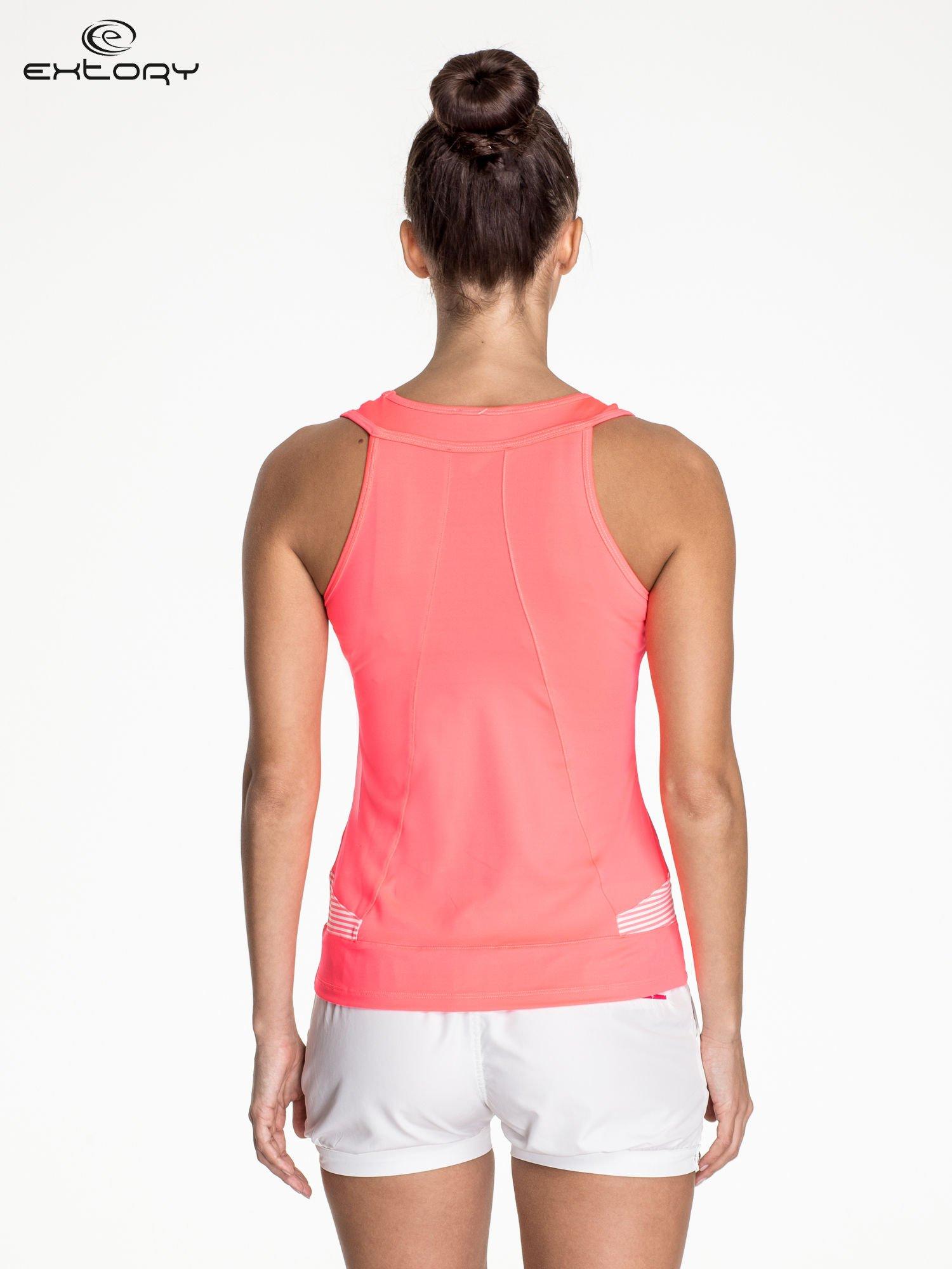 Fluoróżowy top sportowy na fitness                                  zdj.                                  4